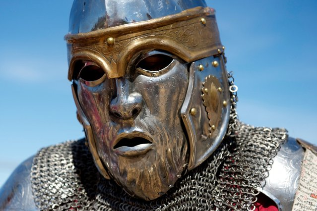 A member of the USA Knights team is seen wearing a face-like helmet shield during the International Medieval Combat championships at the castle of Belmonte, May 4, 2014, in Belmonte, Spain. The steel armor the knights wear can cost up to $10,000 and weigh 80 pounds. (Photo by Juan Naharro Gimenez/Getty Images)