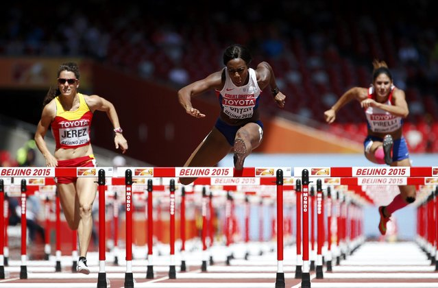 Tiffany Porter of Britain (C) competes in the women's 100 metres hurdles heats during the 15th IAAF World Championships at the National Stadium in Beijing, China August 27, 2015. (Photo by Lucy Nicholson/Reuters)