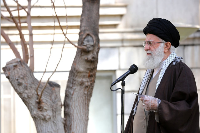 In this photo released by the office of the Iranian supreme leader, Supreme Leader Ayatollah Ali Khamenei speaks during a tree planting ceremony in Tehran, Iran, Tuesday, March 3, 2020. Iran's supreme leader put the Islamic Republic on war footing Tuesday against the new coronavirus by ordering its armed forces to assist health officials in combating the outbreak – the deadliest outside of China – that authorities say has killed 77 people. (Photo by Office of the Iranian Supreme Leader via AP Photo)