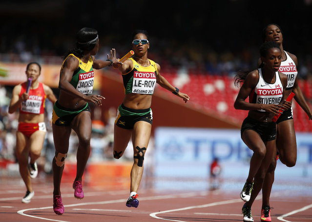 Carline Muir of Canada (R) and Anastasia Le-Roy of Jamaica (C) pass the baton to their teammates Alyanna Stiverne (2nd R) and Shericka Jackson (2nd L) during their women's 4 x 400 metres relay heat at the 15th IAAF Championships at the National Stadium in Beijing, China August 29, 2015. (Photo by Lucy Nicholson/Reuters)