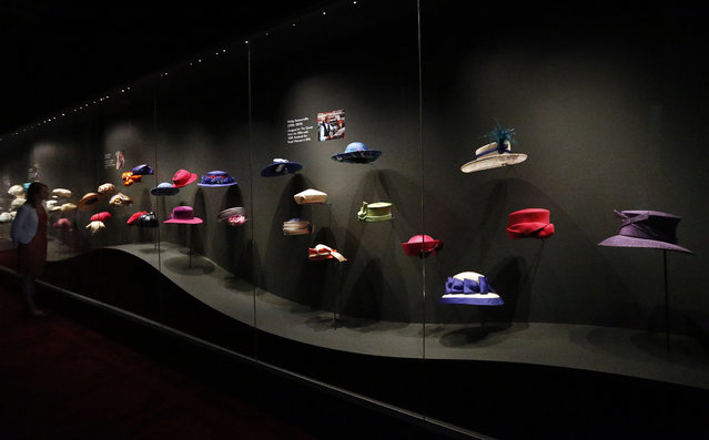 A woman looks at Britain's Queen Elizabeth's  hats at an exhibition at Buckingham Palace in London, Thursday, July 21, 2016. (Photo by Frank Augstein/AP Photo)
