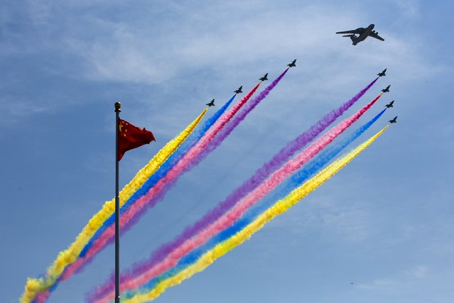 A KJ-2000 airborne early warning and control system leads J-10 fighter jets flying past a national flag during the military parade marking the 70th anniversary of the end of World War Two, in Beijing, China, September 3, 2015. (Photo by Andy Wong/Reuters)