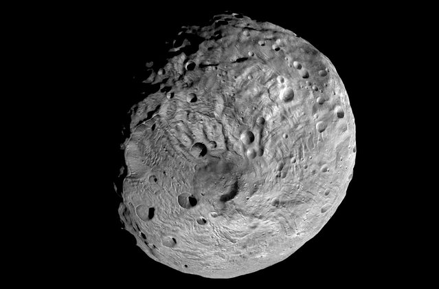This undated image taken by the NASA's Dawn spacecraft shows the south pole of the giant asteroid Vesta. After spending a year examining Vesta, Dawn was poised to depart and head to another asteroid Ceres, where it will arrive in 2015. (Photo by AP Photo/NASA)