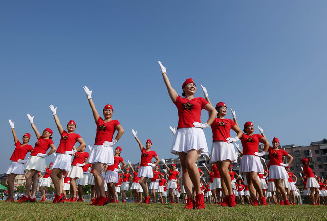 This photo taken on October 8, 2017 shows dancers posing in formation to celebrate the upcoming Party Congress, in Rongan in China' s southern Guangxi region. China will convene its 19 th Party Congress on October 18, state media said, a key meeting held every five years where President Xi Jinping is expected to receive a second term as the ruling Communist Party' s top leader. (Photo by AFP Photo/Stringer)