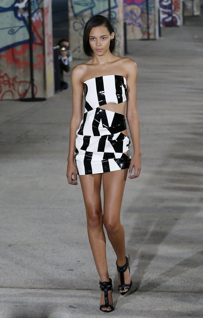A model wears a creation for Anthony Vaccarello's Spring/Summer 2015 ready-to-wear fashion collection, presented in Paris, Tuesday, September 23, 2014. (Photo by Jacques Brinon/AP Photo)