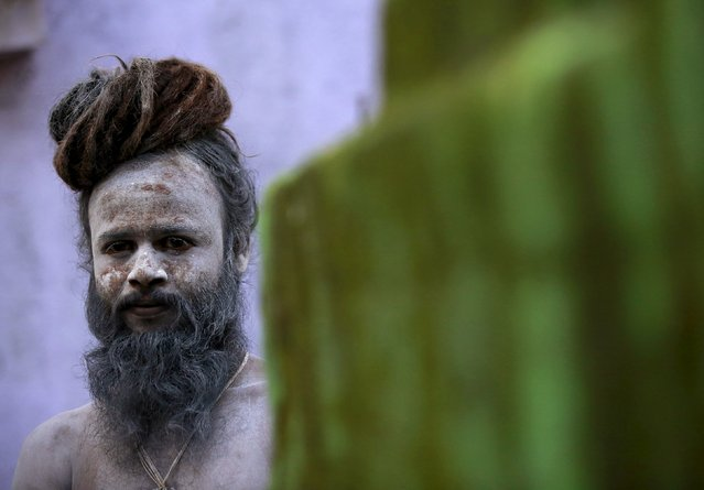"A Naga Sadhu, or Hindu holy man, waits during a procession before taking a dip in a holy pond during the second ""Shahi Snan"" (grand bath) at ""Kumbh Mela"", or Pitcher Festival, in Trimbakeshwar, India, September 13, 2015. (Photo by Danish Siddiqui/Reuters)"