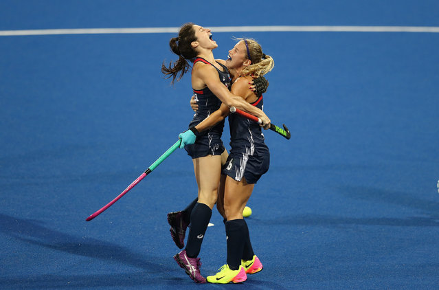 Michelle Vittese (L) of the USA celebrates with team mate Katie Bam after scoring a goal during the Women's group B hockey match between Great Britain and the USA on Day 8 of the Rio 2016 Olympic Games at the Olympic Hockey Centre on August 13, 2016 in Rio de Janeiro, Brazil. (Photo by David Rogers/Getty Images)