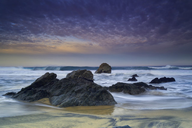 """""""Rocks of Monterey"""". One of my favorite places to shoot in the USA is definitely the Pacific Northwest. For three nights I had no colour to speak of. Certainly nothing that made me get excited. The last day however the wind was strong, the clouds were coming and going fast, and the sunrise that Mother Nature gave us was AMAZING. Truly a beautiful place. Photo location: Monterey, California. (Photo and caption by Michael PA/National Geographic Photo Contest)"""