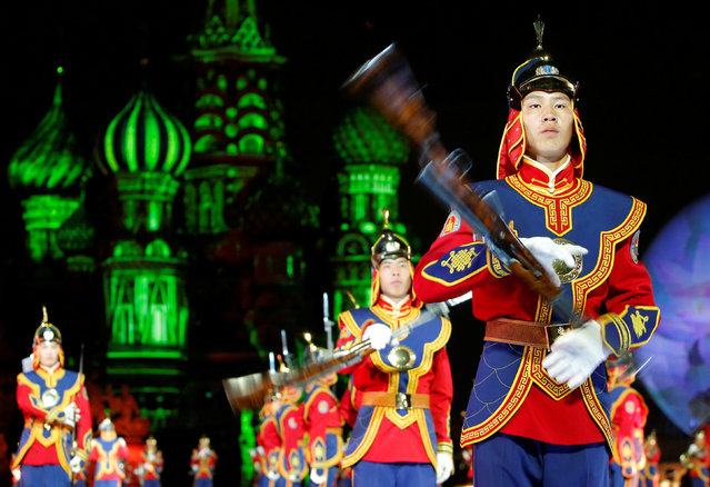 "Members of the Honour Guard and the central military band of the Mongolian armed forces perform during the International Military Music Festival ""Spasskaya Tower"" media preview in Red Square in Moscow, Russia, August 26, 2016. (Photo by Sergei Karpukhin/Reuters)"