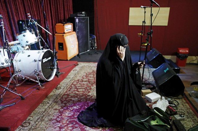 Gisele Marie, a Muslim woman and professional heavy metal musician, talks on her mobile phone before a concert in Sao Paulo December 16, 2014. (Photo by Nacho Doce/Reuters)