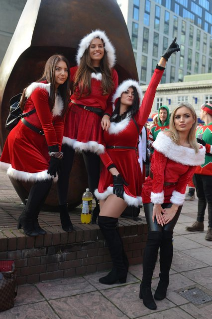 These Santas strike up a pose with their glamorous festive outfits during Santacon day in London, UK, on December 9, 2017. (Photo by Howard Jones/i-Images)