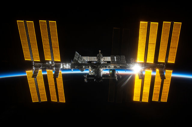 The International Space Station, its construction complete, as seen from Space Shuttle Discovery. (Photo by crew of STS-119 )