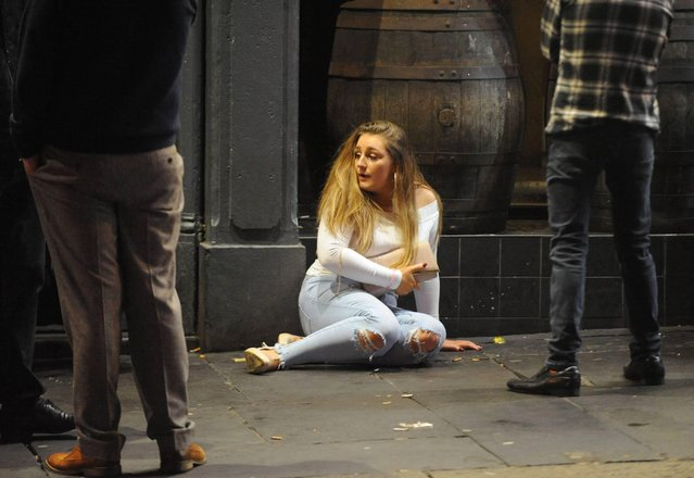 "Revellers out and about in Newcastle, England on ""Black Eye Friday"" or ""Mad Friday"" on December 22, 2017. This partygoer had so much fun she looks lost. (Photo by Craig Connor/North News and Pictures)"