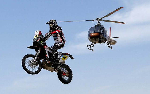 Husqvarna rider Joan Barreda Bort of Spain competes during the 1st stage. (Photo by Victor R. Caivano/Associated Press)