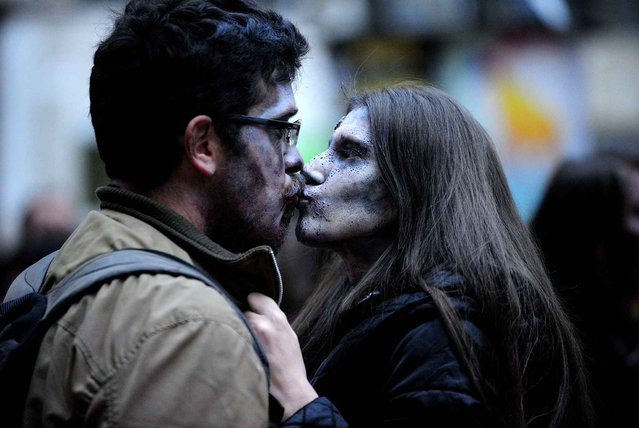 People dressed as a zombie taking part in Zombie Parade on a streets of Belgrade during a zombie walk in Belgrade, on October 26, 2014. (Photo by Oksana Toskic/SIPA Press)