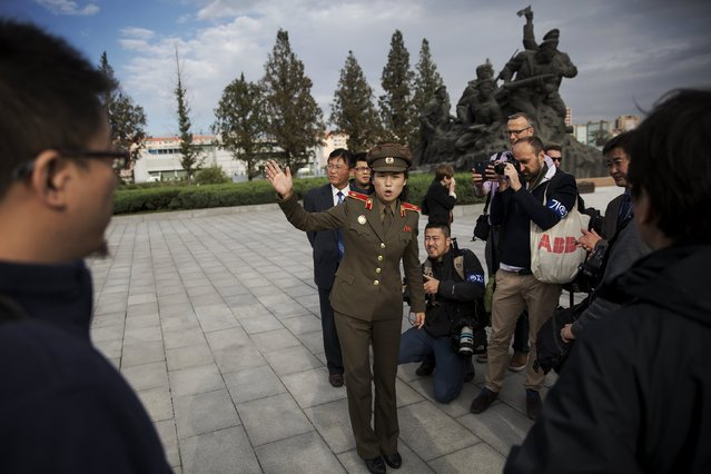 A soldier (C) talks to foreign reporters at the War Museum during a government organised tour in Pyongyang, North Korea October 9, 2015. (Photo by Damir Sagolj/Reuters)