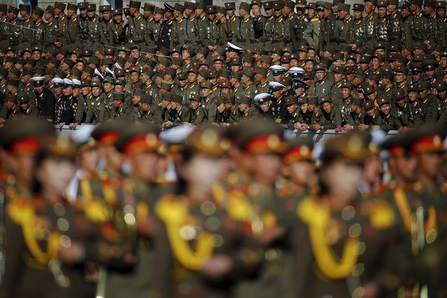 Soldiers watch their comrades marching past a stand with North Korean leader Kim Jong Un during the parade celebrating the 70th anniversary of the founding of the ruling Workers' Party of Korea, in Pyongyang October 10, 2015. (Photo by Damir Sagolj/Reuters)
