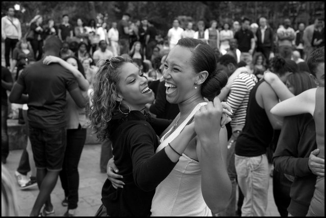 Dancing Kizomba in Paris-a beautiful sensual dance with origins from Angola, resembling Zouk, along the banks of the Seine on Sunday early evening-if you've never seen this dance or heard this music-once you have, you'll never forget it-wonderful! (Photo and comment by Peter Turnley)