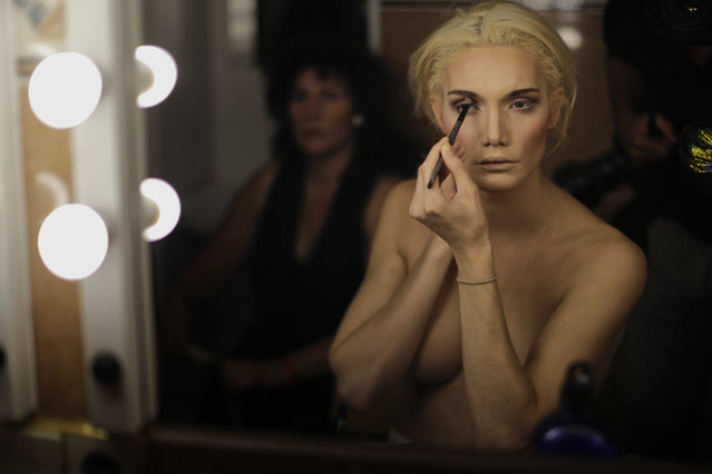 In this Sunday, September 18, 2016 photo, Linni Rows Wiman, from Sweden, applies make up ahead of the Miss Trans Star International 2016 show celebrated in Barcelona, Spain. (Photo by Emilio Morenatti/AP Photo)