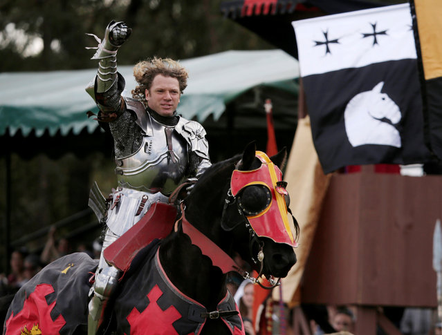 Australian jouster Philip Leitch acknowledges the crowd before donning his helmet and competing in a jousting tournament at the St Ives Medieval Fair in Sydney, one of the largest of its kind in Australia, September 24, 2016. (Photo by Jason Reed/Reuters)