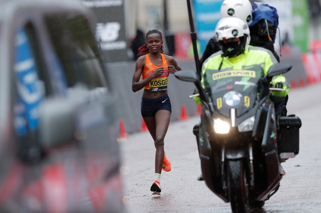 Brigid Kosgei of Kenya competes in the Elite Women's Field during the 2020 Virgin Money London Marathon around St. James's Park on October 04, 2020 in London, England. The 40th Race will take place on a closed-loop circuit around St James's Park in central London. (Photo by Tom Jenkins/The Guardian)