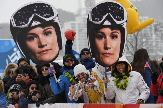 Supporters of Australia's Sami Kennedy-Sim hold up giant cut-outs of her prior to the women's ski cross events during the Pyeongchang 2018 Winter Olympic Games at the Phoenix Park in Pyeongchang on February 23, 2018. (Photo by Loic Venance/AFP Photo)