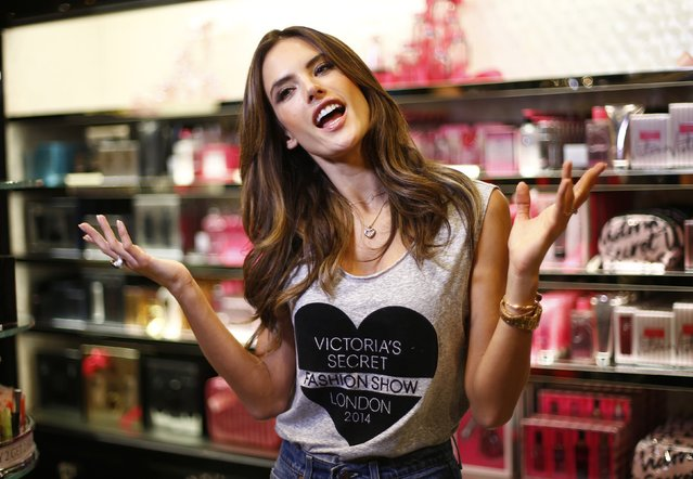 Model Alessandra Ambrosio from Brazil speaks during an interview in the Victoria's Secret shop on New Bond Street in central London, December 1, 2014. (Photo by Andrew Winning/Reuters)