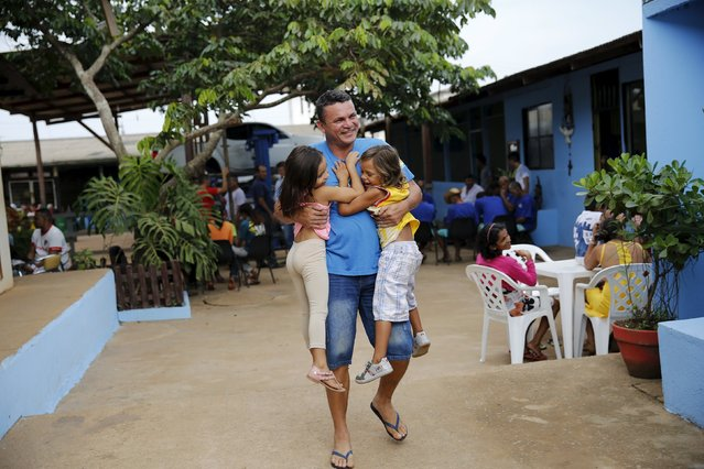 Prisoner Enoque Lucio, 36, jokes with his children during a half-day visit at the ACUDA programme, at a complex of ten prisons in Porto Velho, Rondonia State, Brazil August 28, 2015. Down a dirt road in the Amazonian state of Rondonia, prisoners convicted of murder, theft and other crimes get a rare release from the day-to-day hardships of a penal system known for violence and overcrowding. (Photo by Nacho Doce/Reuters)