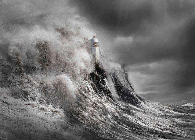 Drama at the Lighthouse, Wales. Your View category winner. A dramatic look at the power of the sea engulfing the lighthouse with huge waves. (Photo by Aleks Gjika/UK Landscape Photographer of the Year 2020)