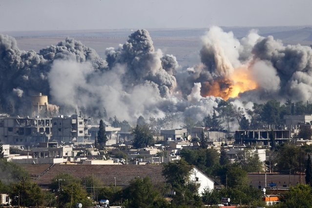 Smoke rises over the Syrian town of Kobani after an air strike, as seen from the Mursitpinar border crossing on the Turkish-Syrian border in the southeastern town of Suruc in Sanliurfa province, in this October 18, 2014 file photo. (Photo by Kai Pfaffenbach/Reuters)