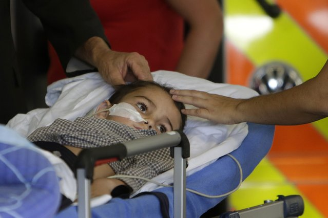 Ashya King, a five-year-old British boy with a brain tumour, lies on a stretcher as he arrives with his parents at Motol hospital in Prague, in this September 8, 2014 file photo. (Photo by David W. Cerny/Reuters)
