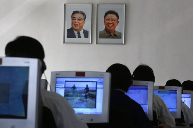 North Korean students use computers near portraits of the country's later leaders Kim Il Sung, left, and his son Kim Jong Il at the Kim Chaek University of Technology in Pyongyang, North Korea Thursday, September 20, 2012. The university was founded in 1948 and its digital e-library was created in 2005. (Photo by Vincent Yu/AP Photo)