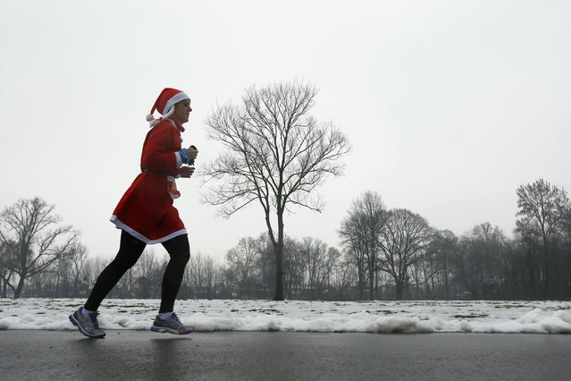 "A costumed runner participates in the ""Santa Claus Run"" in Mogosoaia, near Bucharest December 6, 2014. (Photo by Bogdan Cristel/Reuters)"