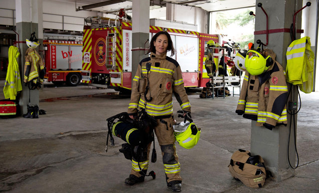 """Maria Jose Martienz Ortiz, 43, Spanish firefighter poses for a picture in the """"Fuente San Luis"""" fire station facilities in Valencia, Spain on February 28, 2018. (Photo by Jose Jordan/AFP Photo)"""