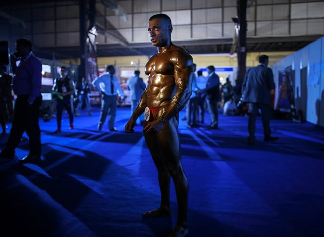 A competitor waits to get onstage during the 6th World Body Building and Physique Sports competition in Mumbai December 9, 2014. More than 400 competitors from 48 countries participated in the competition which was divided into 35 categories, according to a news release. (Photo by Danish Siddiqui/Reuters)