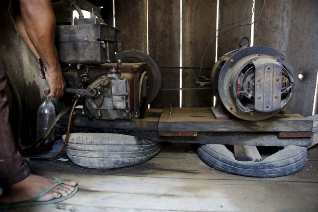 Dercie Alves turns on an electric generator in his house in Rio Pardo next to Bom Futuro National Forest, in the district of Porto Velho, Rondonia State, Brazil, August 30, 2015. (Photo by Nacho Doce/Reuters)