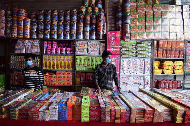 Firecracker vendors wait for customers at a market ahead of Diwali, the Hindu festival of lights, in Allahabad on November 9, 2020. (Photo by Sanjay Kanojia/AFP Photo)