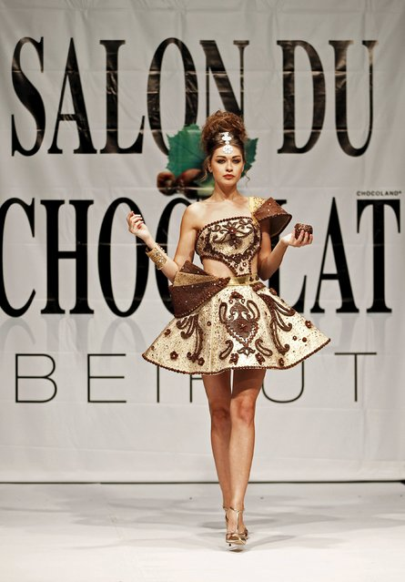 A model presents a creation made with chocolate by Lebanese designer Abed Mahfouz during a Chocolate Fashion Show at the Salon Du Chocolat in Beirut, Lebanon November 12, 2015. (Photo by Jamal Saidi/Reuters)