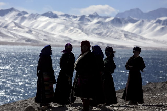 Tibetan people visit Namtso lake in the Tibet Autonomous Region, China November 18, 2015. (Photo by Damir Sagolj/Reuters)