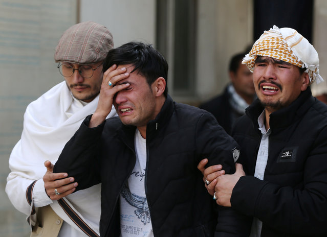 Afghan men cry at a hospital after they heard that their relative was killed during an attack in Kabul, Afghanistan on March 6, 2020. (Photo by Omar Sobhani/Reuters)