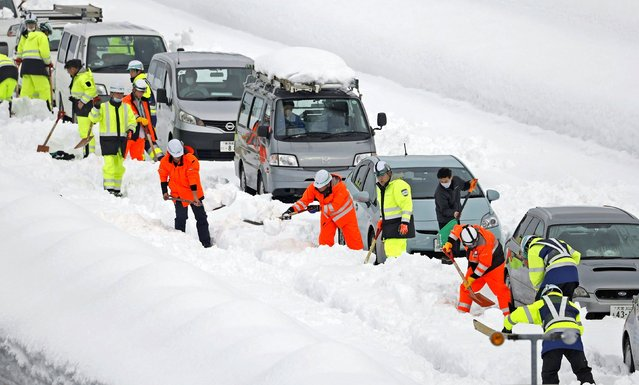 Vehicles are stranded on the snow-covered Kanetsu Expressway in Minamiuonuma in Niigata Prefecture, northwest of Tokyo, on December 18, 2020. (Photo by Kyodo News/Action Press via Reuters)