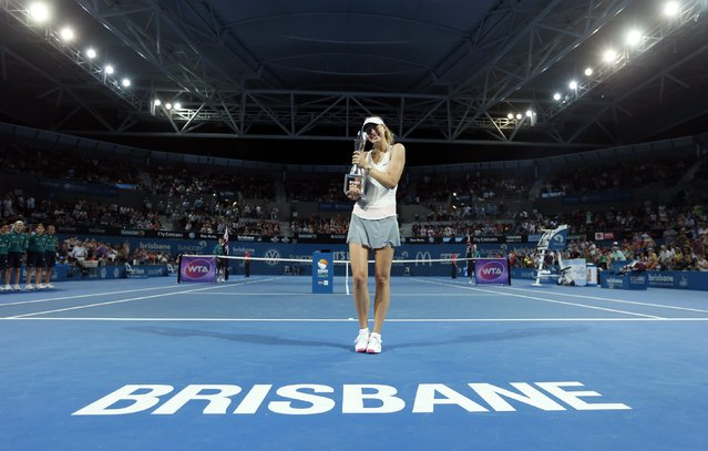 Maria Sharapova of Russia holds the Brisbane International tennis tournament women's singles trophy after defeating Ana Ivanovic of Serbia in Brisbane, January 10, 2015. (Photo by Jason Reed/Reuters)