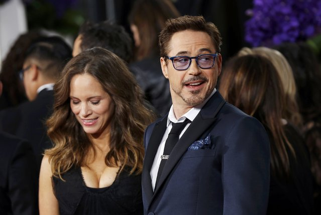 Actor Robert Downey Jr. and Susan Downey arrive at the 72nd Golden Globe Awards in Beverly Hills, California January 11, 2015. (Photo by Mario Anzuoni/Reuters)