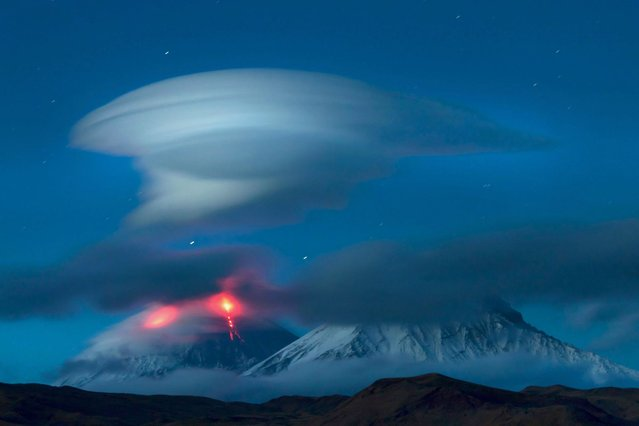 Lenticular clouds over the mountains of the Kamchatka Peninsula in Russia. (Photo by Denis Budkov/Caters News)