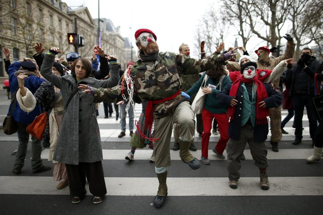 Environmentalists dance during a protest near the Place de la Republique after the cancellation of a planned climate march following shootings in the French capital, ahead of the World Climate Change Conference 2015 (COP21), in Paris, France, November 29, 2015. (Photo by Benoit Tessier/Reuters)