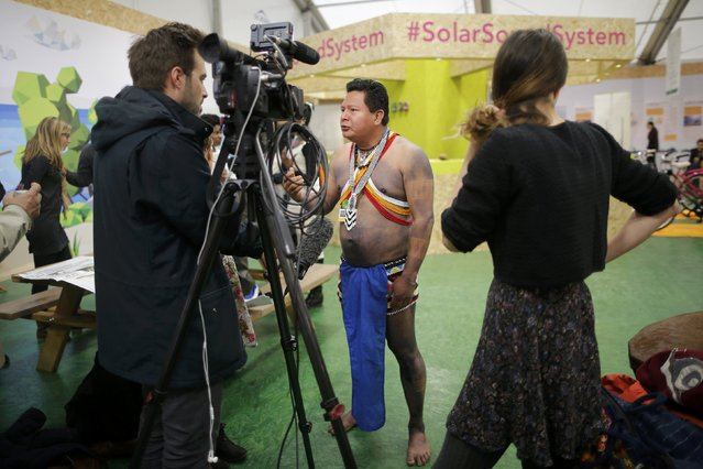Candido Mezua, representative of the National Coordinating Body of Indigeneous Peoples in Panama (COONAPIP) and the Alliance of Mesoamerican Peoples and Forests talks to the media during the World Climate Change Conference 2015 (COP21) at Le Bourget, near Paris, France, December 2, 2015. (Photo by Stephane Mahe/Reuters)