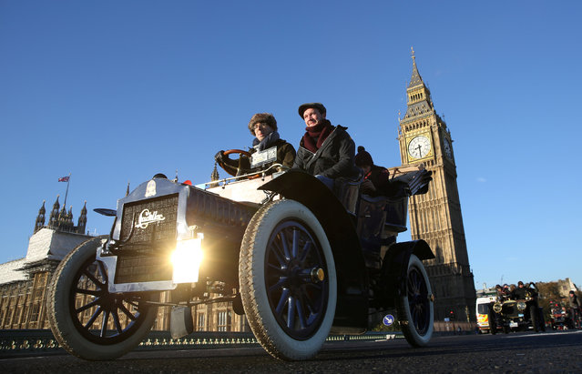 A vintage car drives over Westminster bridge during the annual London to Brighton veteran car run in London, Britain, November 6, 2016. (Photo by Neil Hall/Reuters)