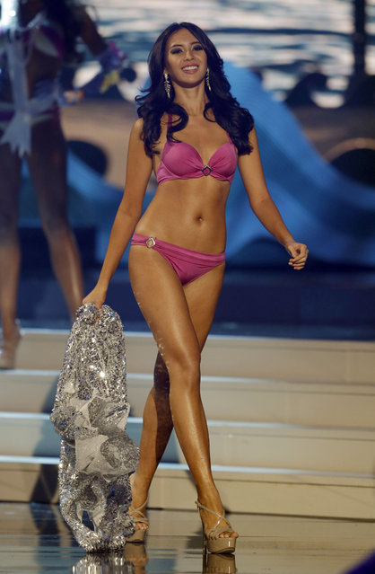Miss Indonesia Elvira Devinamira walks in her swimsuit during the Miss Universe pageant in Miami, Sunday, January 25, 2015. (Photo by Wilfredo Lee/AP Photo)