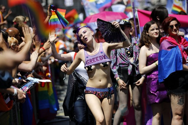 Members of the Lesbian, Gay, Bisexual and Transgender (LGBT) community take part in the annual Pride Parade in London on July 7, 2018. (Photo by Tolga Akmen/AFP Photo)