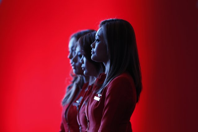Flight attendants of the long-haul carrier AirAsia X watch a performance during the launch of the company's prospectus in Kuala Lumpur in this June 10, 2013 file photo. Struggling Malaysian long-haul budget carrier AirAsia X announced a $109 million equity rights issue to shore up its weak financing and reshuffled top management in a bid to turn around its fortunes. AirAsia X, an affiliate of Asia's largest budget carrier group AirAsia AIRA.KL, said on January 30, (Photo by Bazuki Muhammad/Reuters)